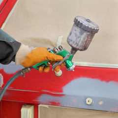 Car painting, ready for repaint worker hand and car airbrush