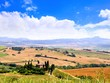 View over the fields of Tuscany, Italy under blue skies