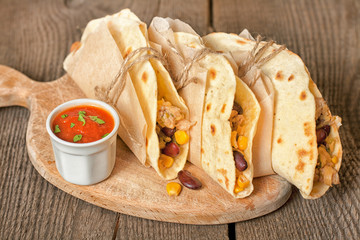 Tortillas with chicken, vegetables and cheese