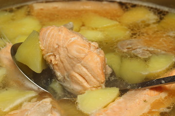 Closeup of a bowl with salmon soup