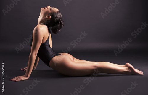 woman with sexy body doing yoga