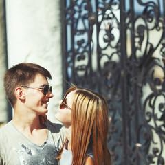 Teen couple bonding, posing together.