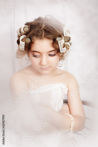 happy beautiful girl with curlers on her head