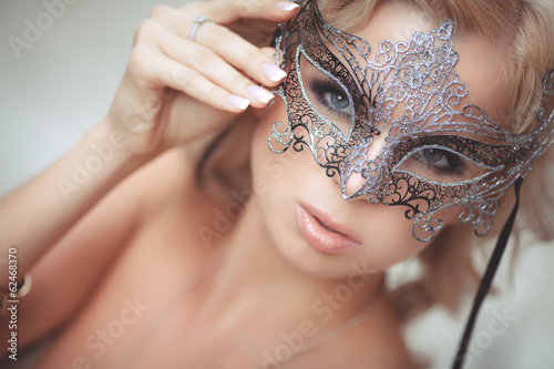 Vogue sexy woman in Venetian mask