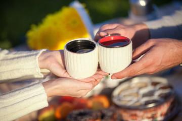 Man and woman drink tea on picnic lifestyle teatime