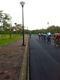 People practise riding bicycles on a track