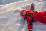 Little girl lying in the snow