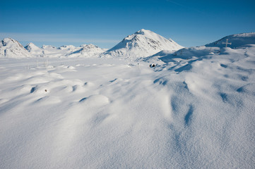 Winter snowy landscape of Kulusuk, small village in Greenland.