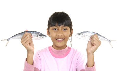 cute smile little girl holding fresh fish