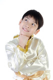 Asian cute boy in thai costume on white background .
