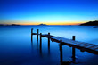 Sunset seascape with wooden jetty