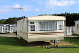 Trailer on caravan park in summer