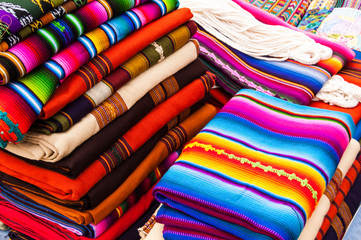 Colorful handwoven Guatemalan textiles in market