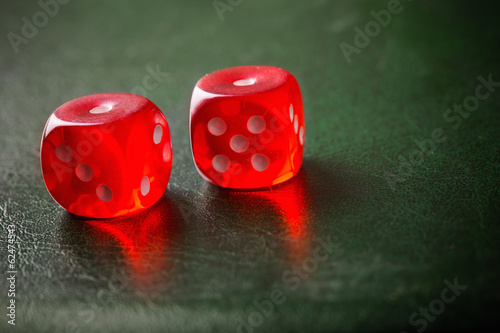 Pair of thrown red dices on green table