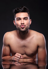 naked young man prepares to kiss