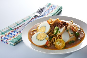 Malaysia favorite spicy noodle mee rebus with fish cake egg