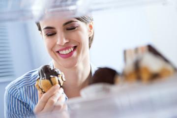 Woman eating sweet food