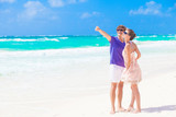 couple in bright clothes on tropical beach in Thailand. gesture