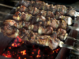kebab meat skewered over a fire