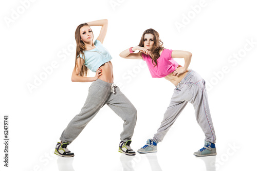 cool looking two dancing women on white background