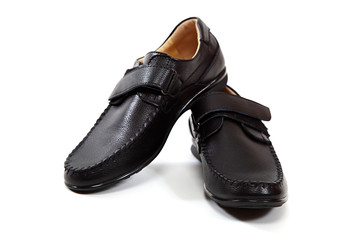 Stylish men's shoes on a white background.