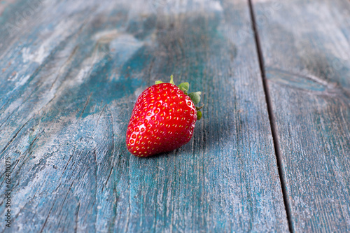Fresh strawberries on the old board.