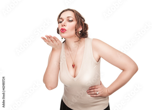 Beautiful plus size woman sending kiss