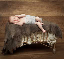 pretty  newborn girl sleeping on a cot