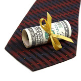 Roll of banknotes and tie.