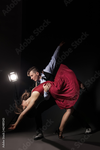 Man and woman in the most romantic dance tango Plakát