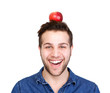Smiling man balancing apple on head