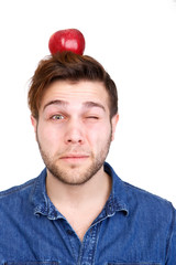 Balancing red apple on head