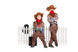 Two boys wearing cowboy costumes