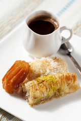 Oriental sweets assortment with cup of coffee