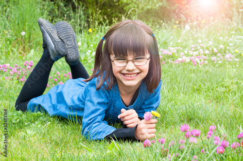 Happy little girl picking flowers