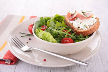 vegetable salad and bread with cheese