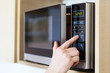 Leinwandbild Motiv Using microwave oven