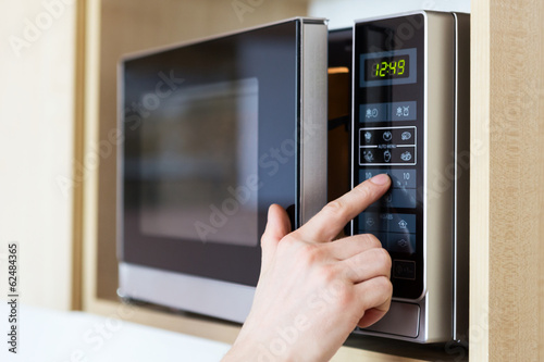 Using microwave oven - 62484365