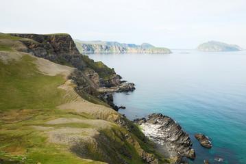 Steep shore of Soroya in summer