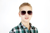 Smiling boy in sunglasses. Youth fashion.