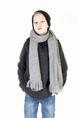 boy in a cap and a scarf. Youth fashion