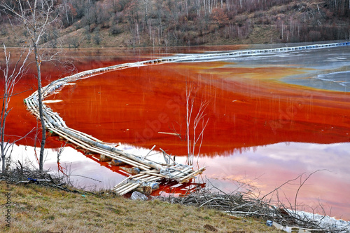 Pollution of a lake with contaminated water - 62485935