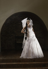 Dramatic bride standing in alcove