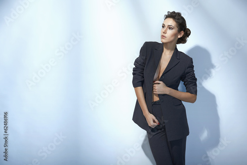 Sensual fashion woman posing in unbuttoned jacket