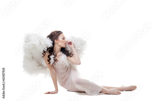 Innocent cute girl posing in angel costume