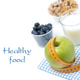 healthy food concept - apple, blueberry, milk and muesli