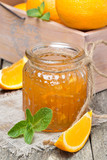 orange marmalade in a glass jar, vertical