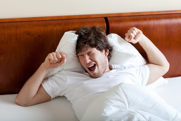Yawning man after awakening