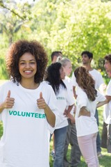 Female volunteer gesturing thumbs up