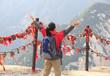 cheering woman hiker at peak of mountain huashan